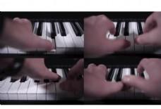 近距离拍摄双手弹钢琴